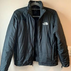 Black puffy North Face jackcet